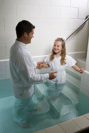 A child getting ready to be baptized under water