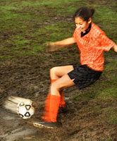teenage girl playing soccer
